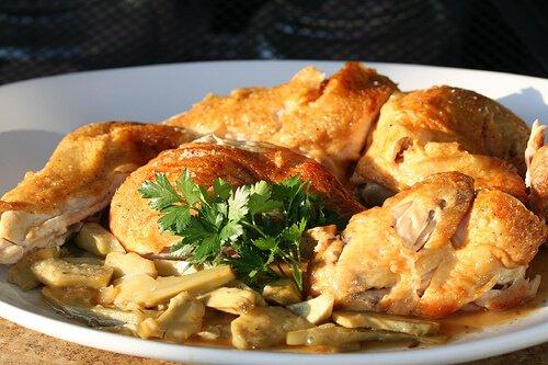 split roast chicken on plate