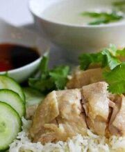 Hainanese chicken and rice on a white plate