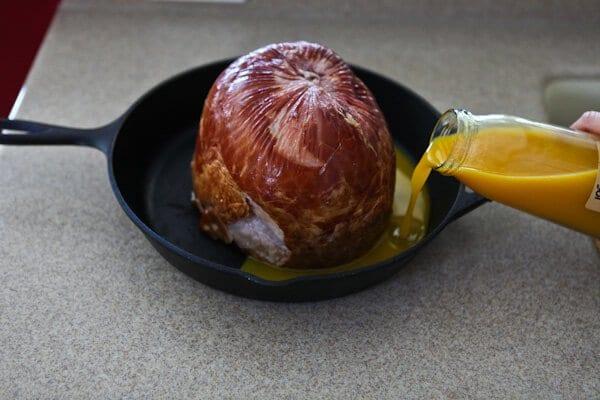 pouring juices onto ham