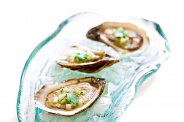 Oysters and Sea Salt - why do so many people overwhelm the delicate flavor of oysters with horseradish and cocktail sauce? Just use a light mignonette and sea salt.