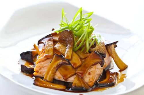 Grilled salmon topped with teriyaki mushrooms
