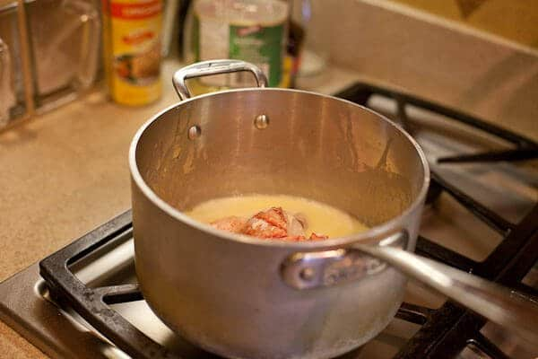butter poached lobster in pot