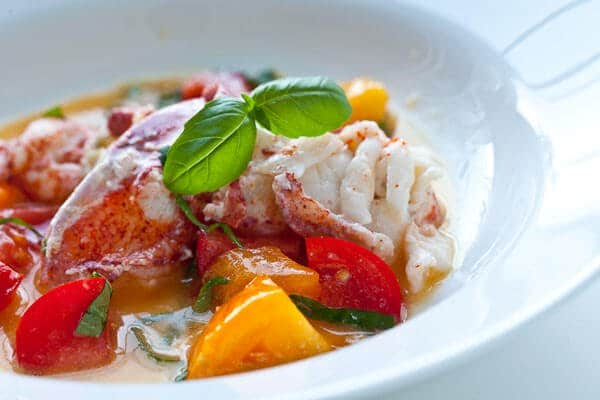basil leaves on butter poached lobster