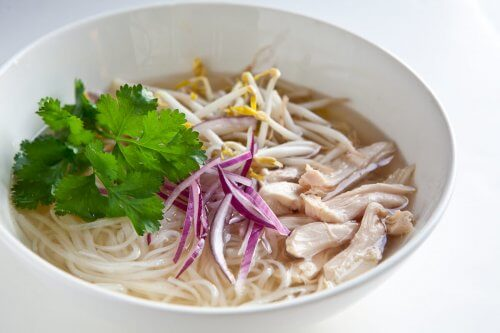 slow cooker pho in a white bowl