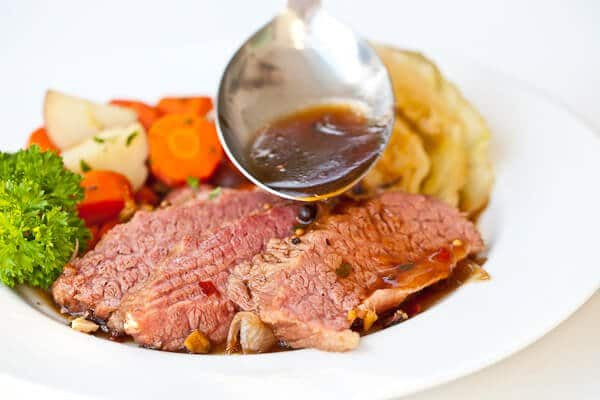 sauce going onto guinness corned beef