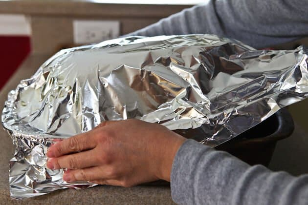 covering ham with foil