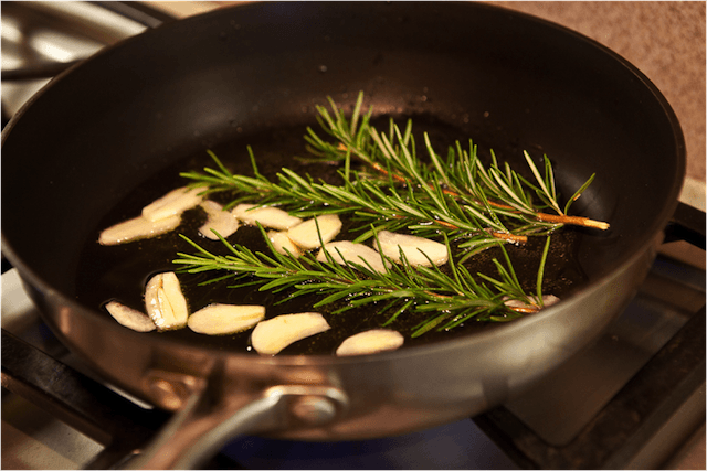 ... low and immediately add in thin garlic slices and sprigs of rosemary