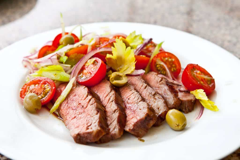 Flank Steak with Bloody Mary Tomato Salad Recipe - Serve salad over steak