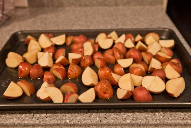 Potatoes on a sheet pan before roasting