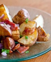 Bacon potato salad served on a glass plate