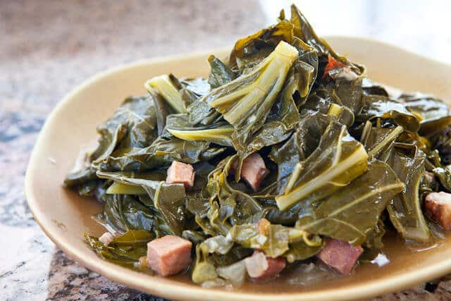 How long to cook collard greens with ham hocks