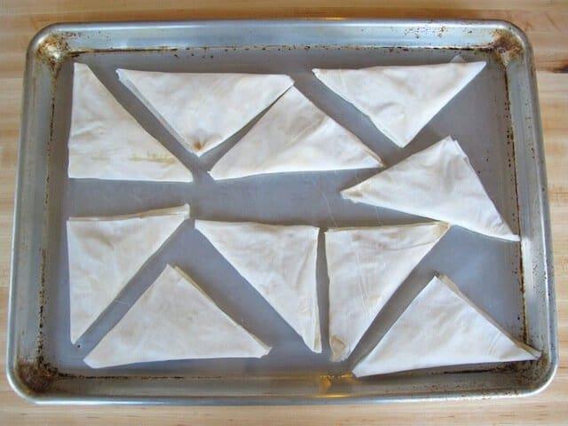 baking tray with unbaked bourekas