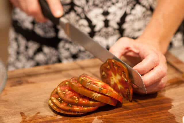 slicing tomatoes for Zucchini Frittata Recipe