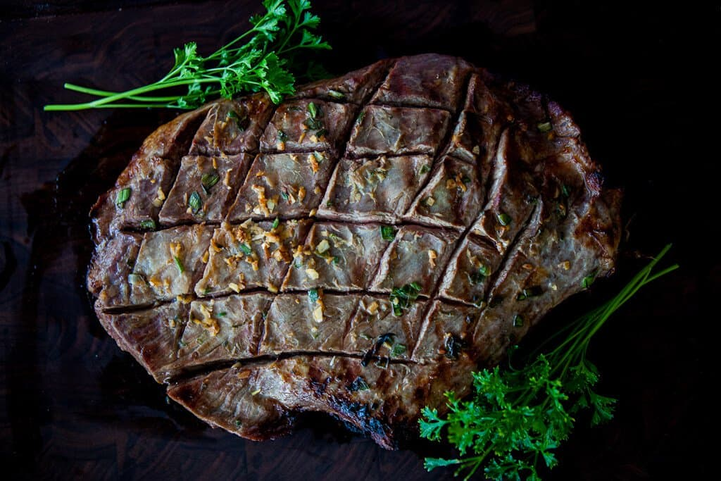 Asian steak garnished with herbs