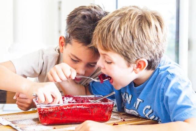The boys eating cake
