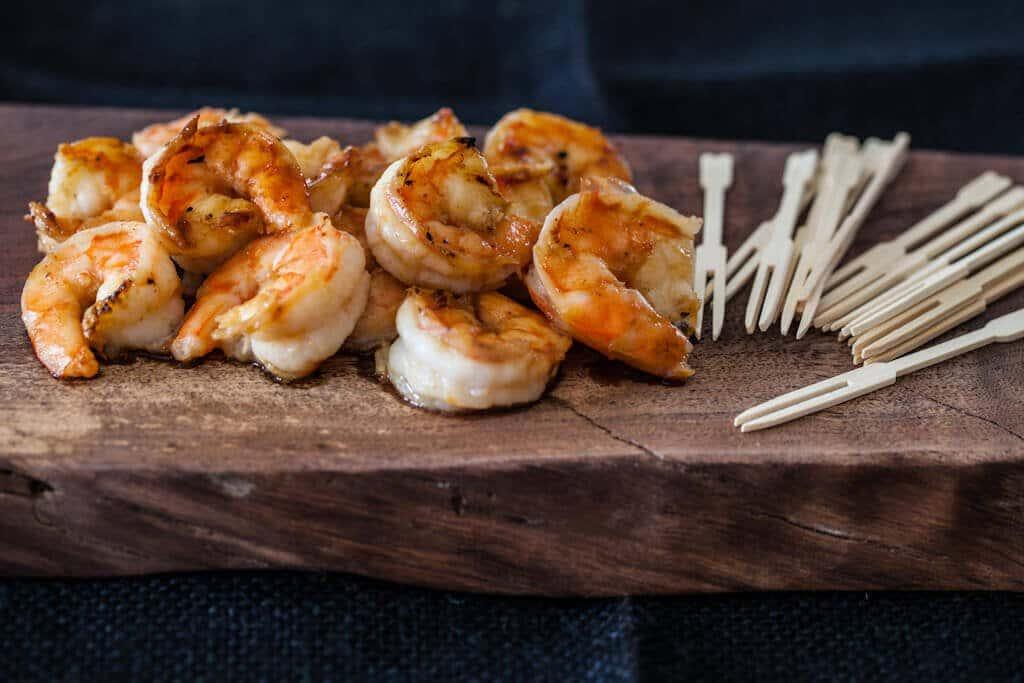 shrimp on wood plank