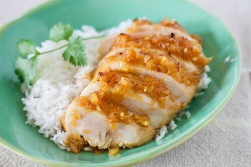 Pineapple chicken teriyaki served with rice on a blue plate