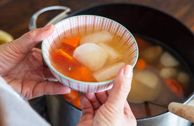 holding Chinese Daikon and Carrot Soup Recipe