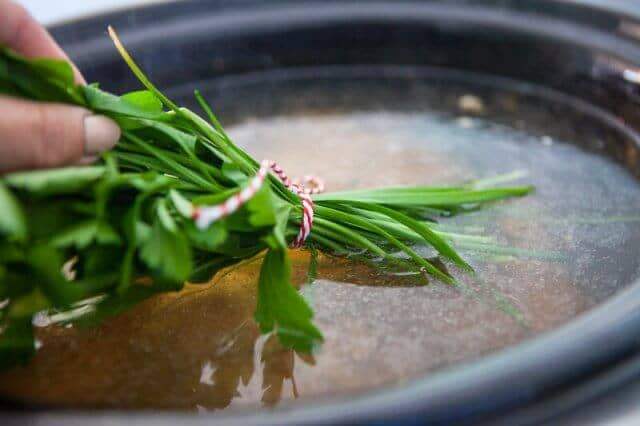 Slow Cooker Bone Broth Recipe - Asian discard spent herbs and add garlic chives and cilantro