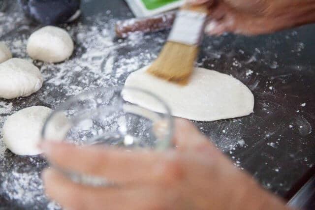brushing oil on dough