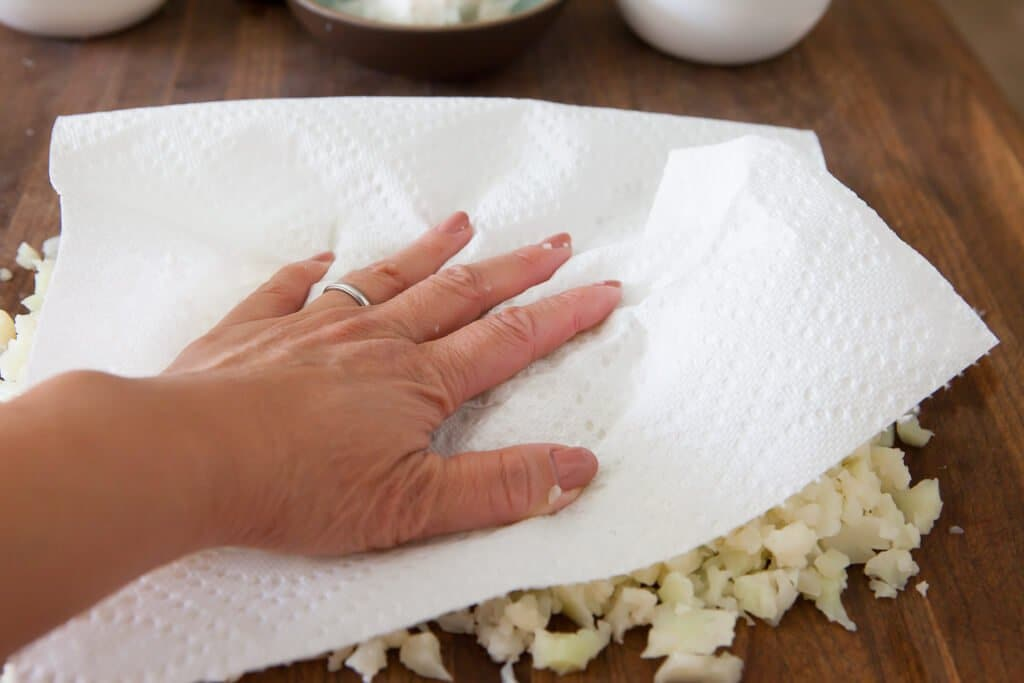 blotting cauliflower dry to make rice