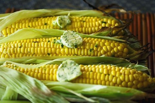 Grilled corn topped with butter