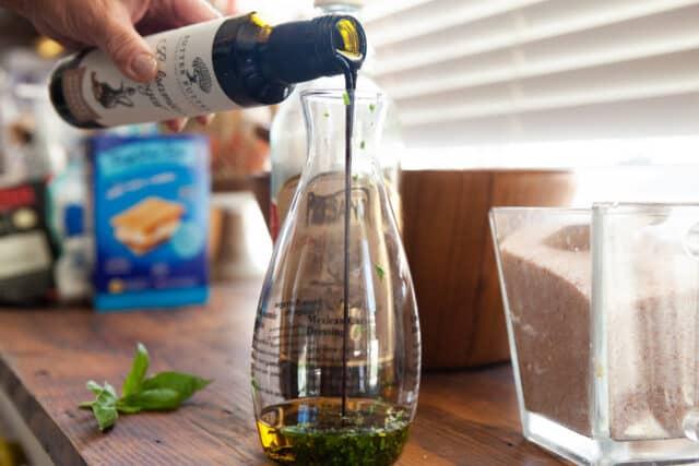 making salad dressing with bonjour salad dressing maker - add in the balsamic