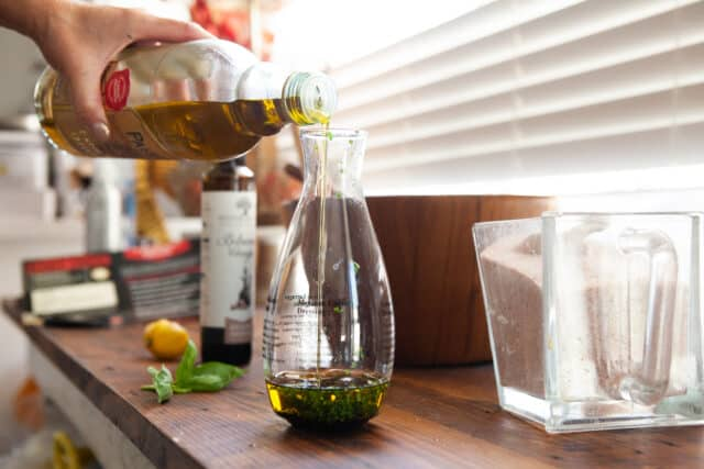 making the salad dressing - add herbs olive oil