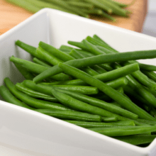 steamed green beans in a bowl