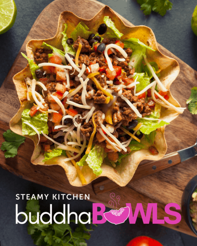buddha bowl with taco shell bowl, ground beef, tomato, lettuce, and cheese