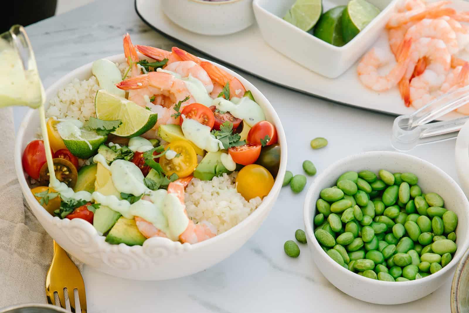 Shrimp avocado Buddha bowl with cilantro lime crema