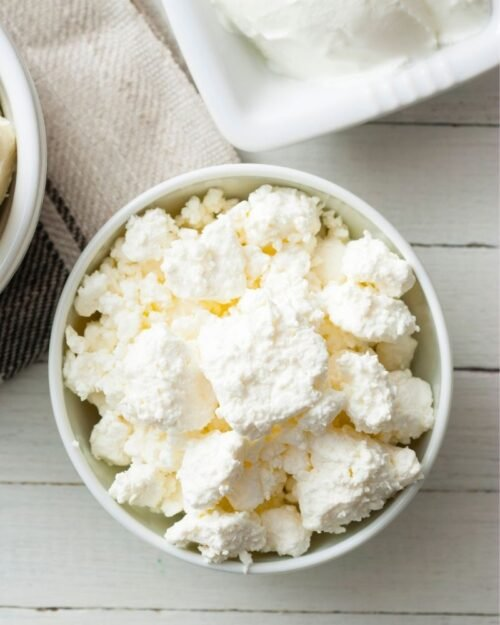 homemade ricotta cheese in a white bowl.