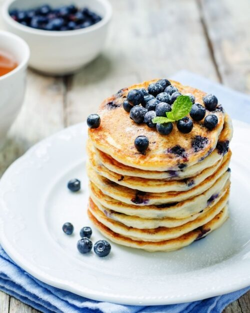 blueberry pancakes from sour milk on a white plate.
