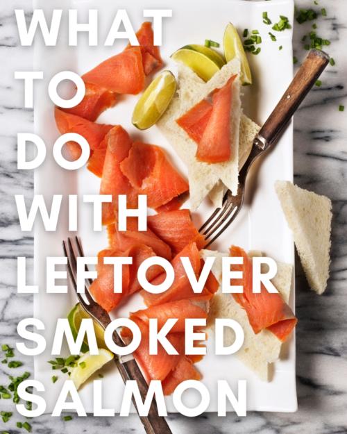 Smoked salmon slices on a white platter.
