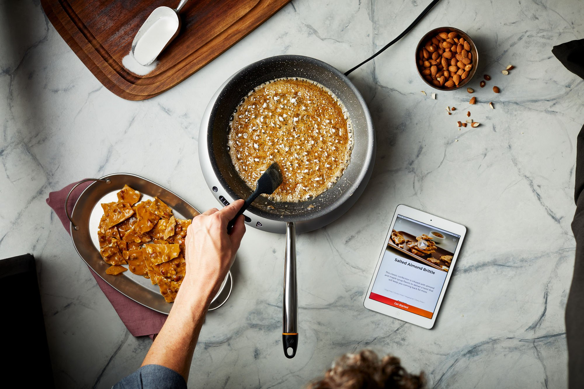 The Hestan Cue cookware and induction cooktop are connected to the app