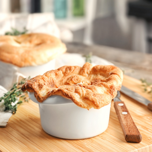 Chicken pot pie in a white ramekin.
