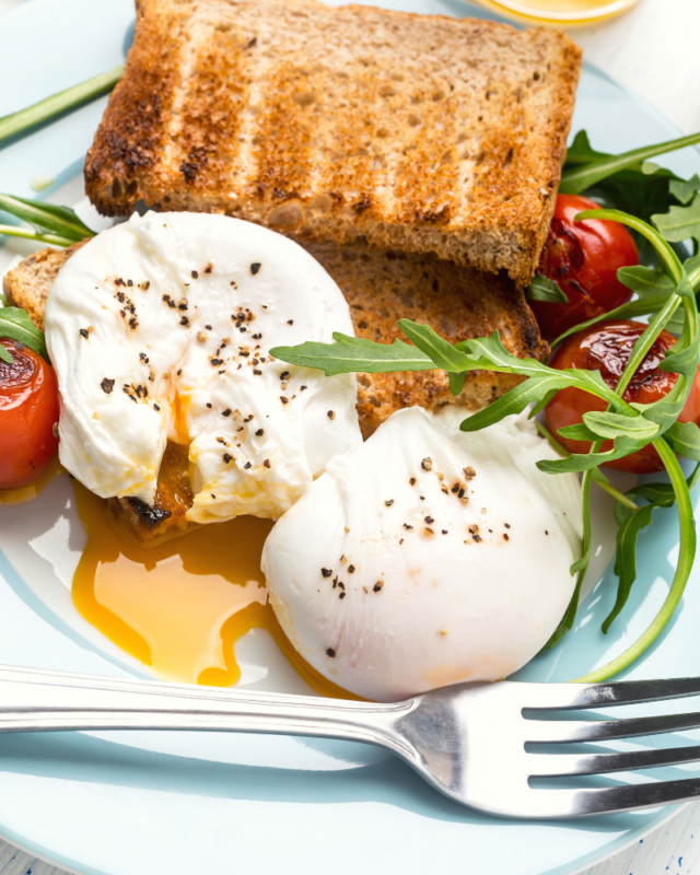 two poached eggs with salt and pepper.
