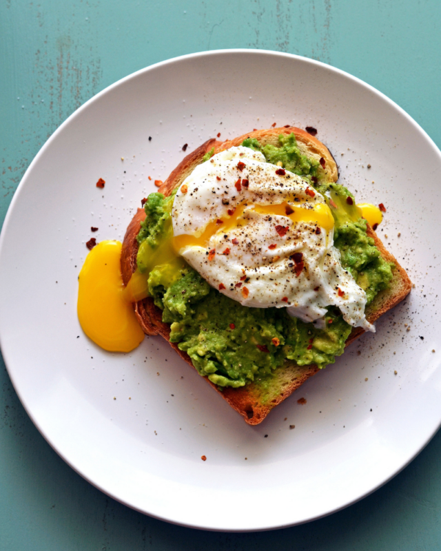 one poached egg on an avocado toast.