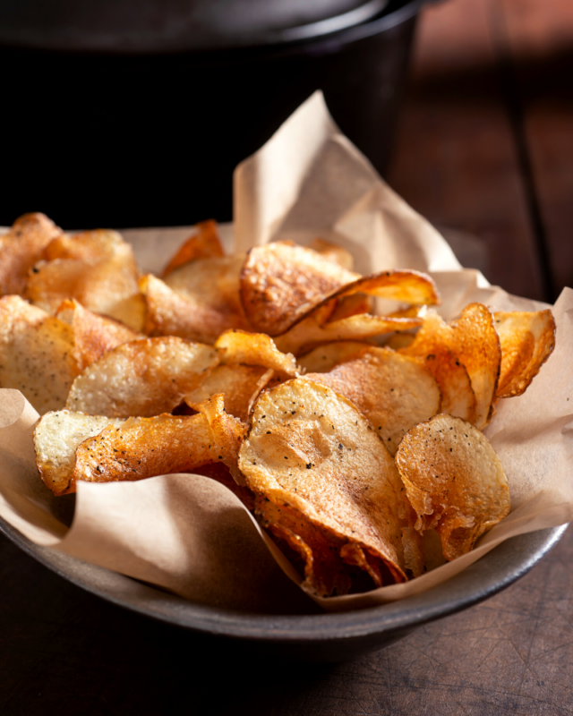 Big bowl of homemade potato chips.