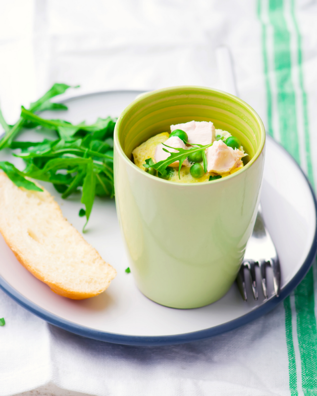 microwave quiche with chicken and peas in green mug.
