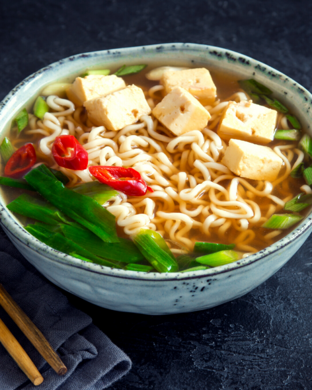 One bowl of ramen with tofu and greens.
