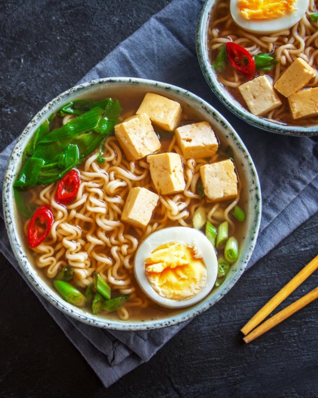 two bowls of ramen noodle soup.
